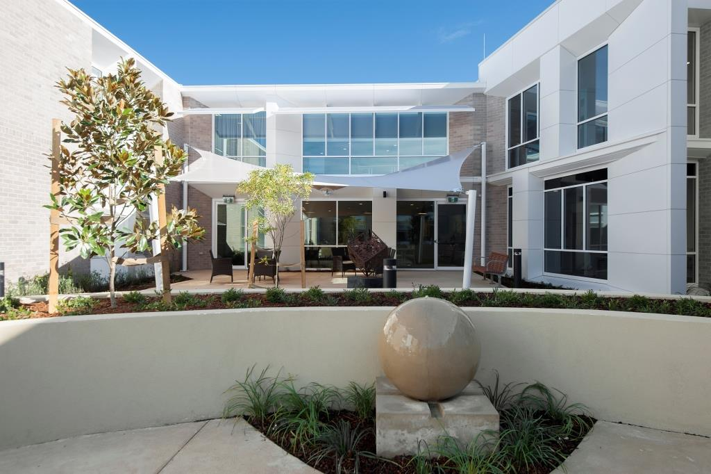 A modern and spacious courtyard at Whiddon Easton Park, an aged care home in Glenfield.