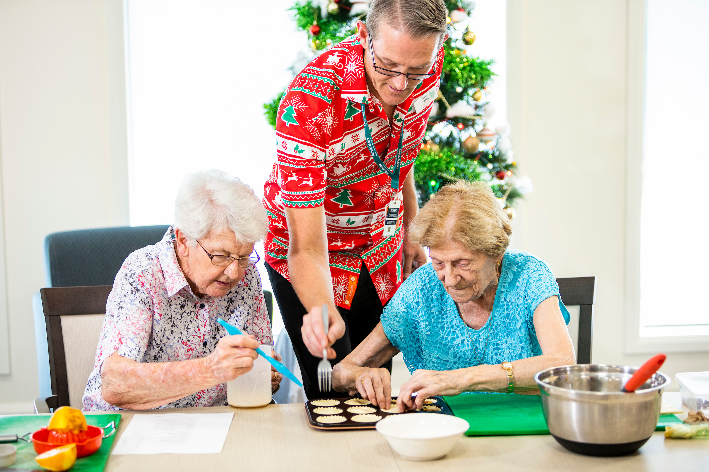 Residents participating in cooking class with Leisure Officer