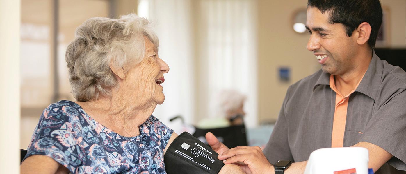 Whiddon nurse checking client's blood pressure